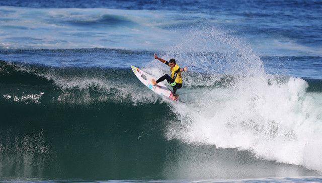 Adriano De Souza of Brasil (pictured) winning his Round 1 heat with a near perfect 9.73 (out of a possible 10) at the Oi Rio Pro in Barra De Tijuca, Rio, Brasil.