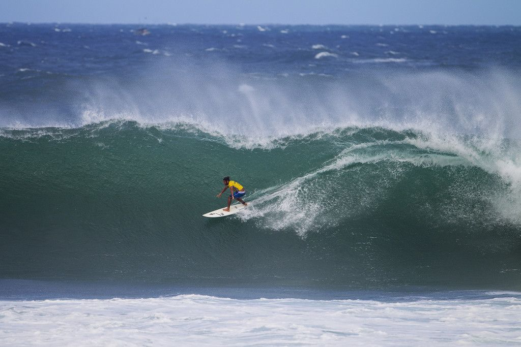 Marco Giorgi of Uraguay (pictured) posting one of the highest rides of the day, a 9.30 (out of a possible 10.00) to advance into the next round at the Vans World Cup of Surfing on Saturday November 28, 2015.